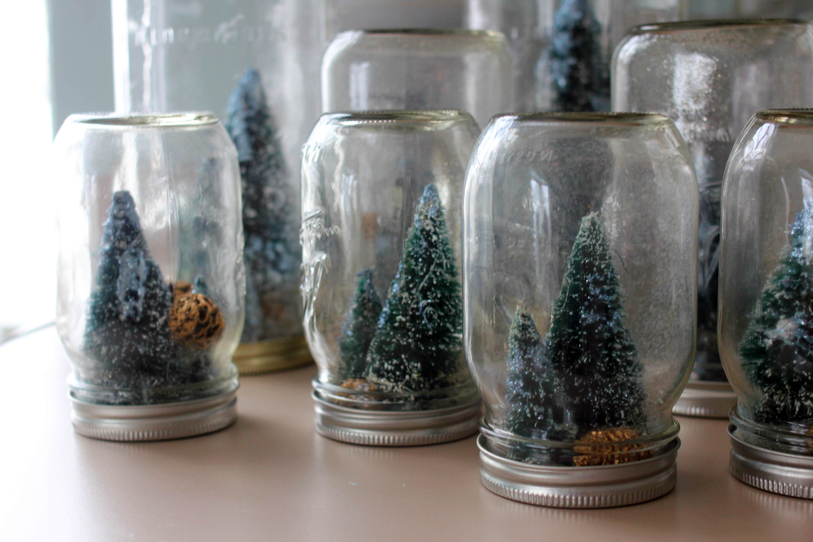 Inspired crafted homemade holiday mason jar snowglobes for Easy homemade christmas snow globes