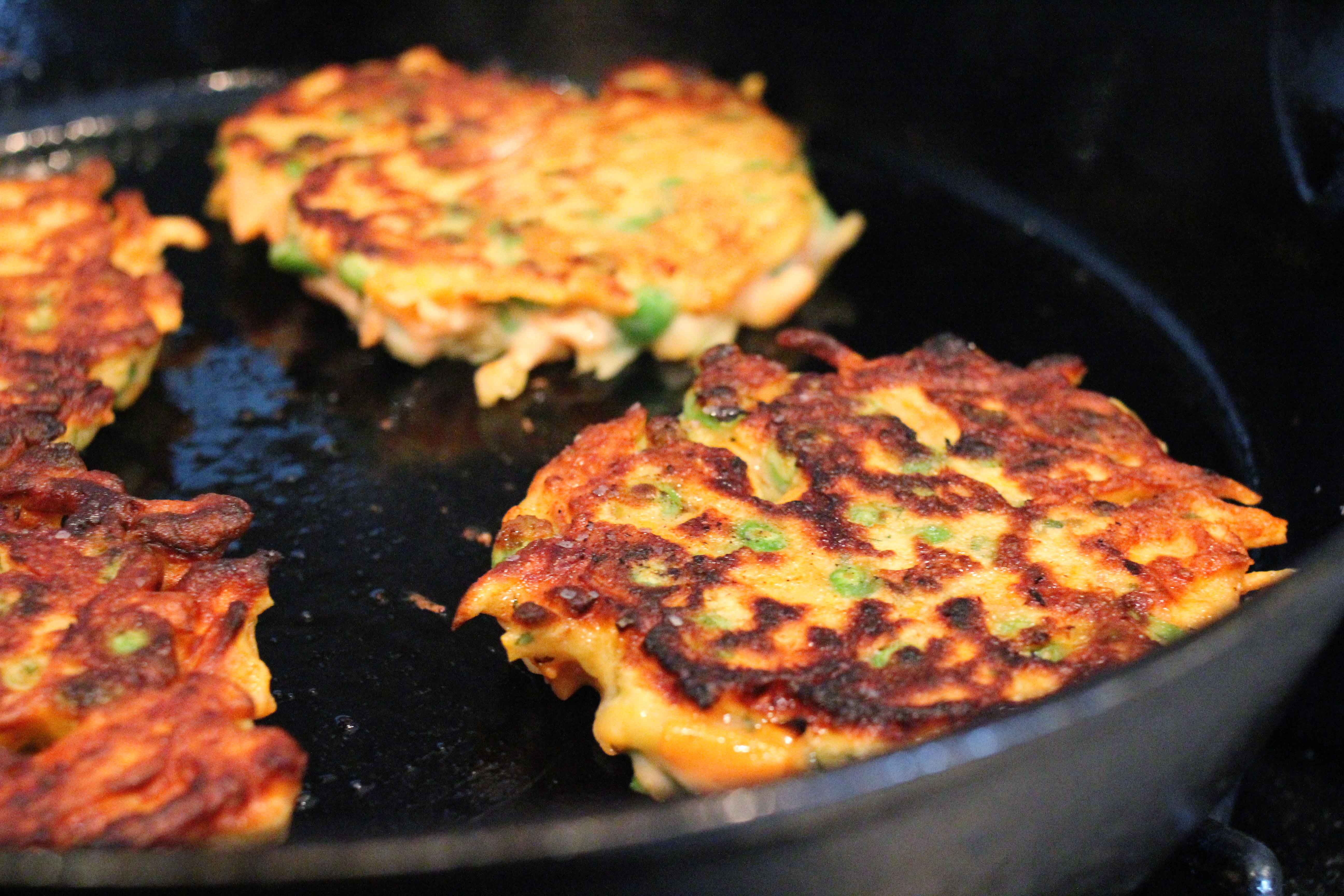sweet potato and pea cakes cooking the cakes