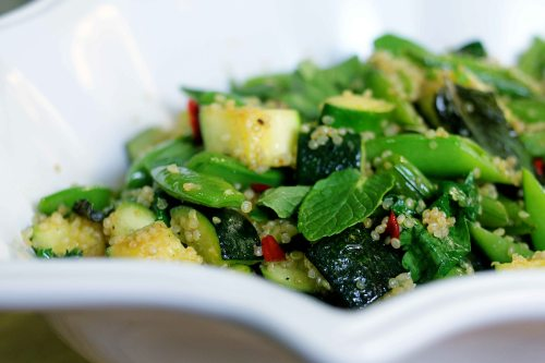 loads of fresh mint, cilantro, and parsley brighten up this zucchini and sweet pea quinoa