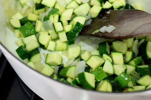 sauteeing up chunks of zucchini for zucchini and basil soup
